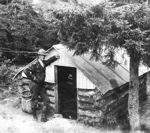 A ranger visits the observer's cabin on Crane Mountain.
