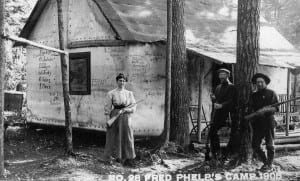 Fred Phelps, center, poses in 1908 with two companions outside his hunting cabin near Cranberry Lake.