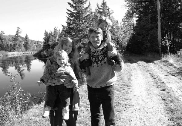 The Kanze family—Debbie with daughter Tasman, Ed with son Ned—near their home on the Saranac.