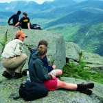 Summit stewards teach hikers about alpine flora.