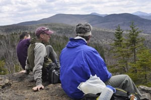 Alan Wechsler, Phil Brown, and Rick Karlin take in the views of the High Peaks from Nun-da-ga-o Ridge. Photo by Ken Aaron.