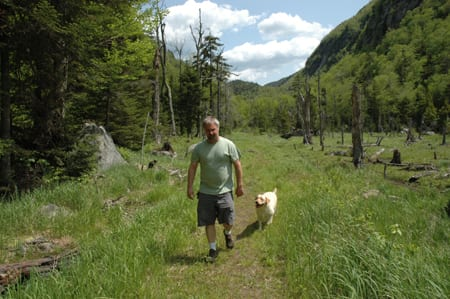 Jim McCulley walks on the Old Mountain Road with his dog, Cherokee. Photo by Susan Bibeau.