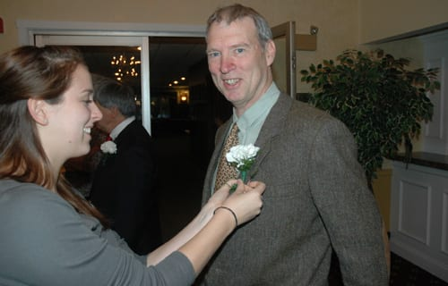 My daughter Rebecca pins a boutonniere on my lapel. Photo by John Kettlewell/ADK