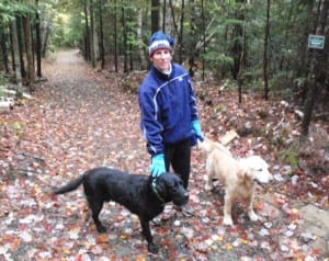 Donna Moody of Lake Placid enjoys a walk with her dogs, Rider (a black Labrador, and Ranger (a golden retriever).