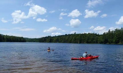 Kayakers in the motor-free St. Regis Canoe Area. Photo by Phil Brown.
