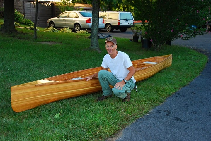 Mike Nolan with the cedar-strip canoe he won in a raffle.