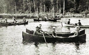 Local guides row tourists on the Fulton Chain of Lakes.