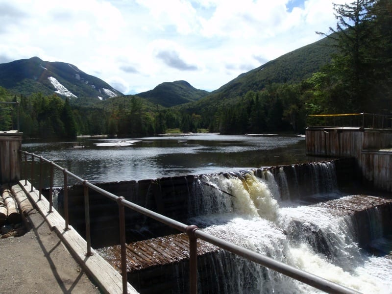 The bridge had spanned the outlet of Marcy Dam. Photo by Phil Brown.