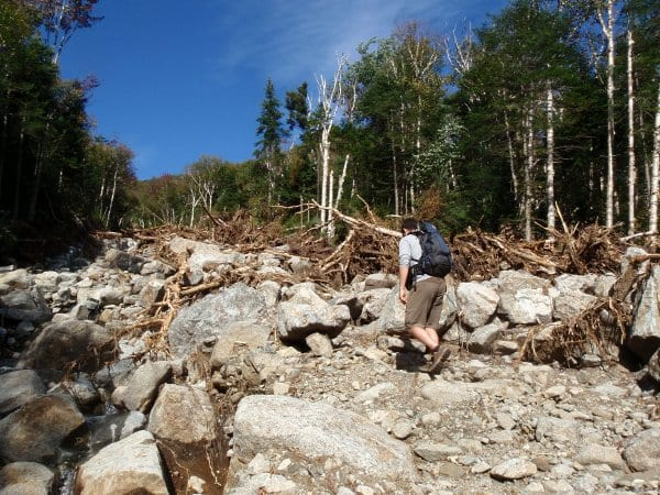 Josh hikers over rubble on the lower part of the slide. Photo by Phil Brown.