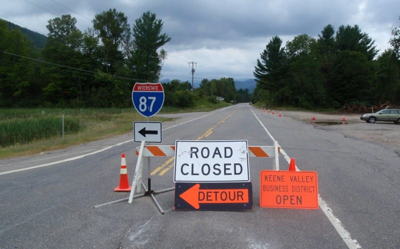 Keene Valley business owners want this barricade removed. Photo by Phil Brown.