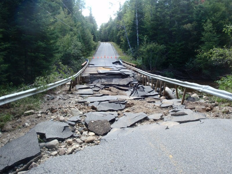 The West Branch of the Ausable undercut this section of Adirondak Loj road. Photo by Phil Brown.