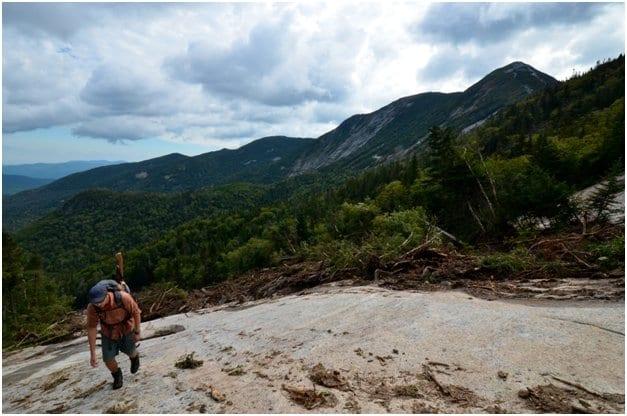 A hiker ascends the new slide on Saddleback Mountain. Photo by Brendan Wiltse.