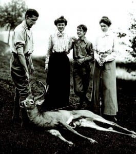 Dr. Edward L. Trudeau Jr., Wenonah Wetmore, William Seward Webb Jr., and Frederica Vanderbilt Webb, with a young stag, 1902.
