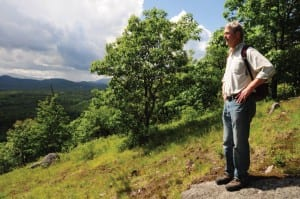 CATS Executive Director Chris Maron takes in the view from Cheney Mountain. Photo by Susan Bibeau