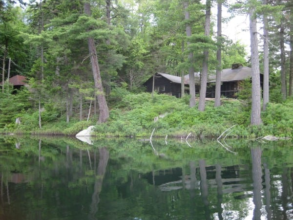 The rustic lodge on Mays Pond. Photo courtesy of Adirondack Land Trust.