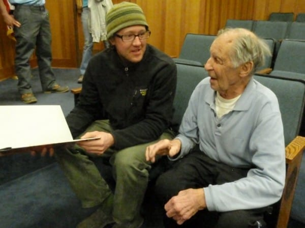 Local climber Will Roth chats with Fred Beckey at Northwood School in Lake Placid Monday night. Photo by Phil Brown.