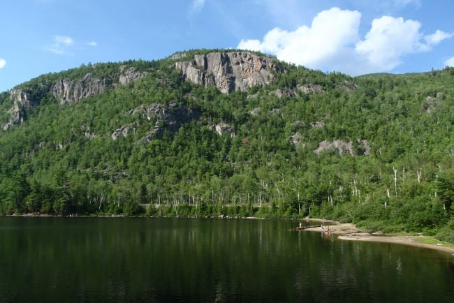 One of the route closures: Upper Washbowl Cliff seen from Chapel Pond. Photo by Phil Brown.
