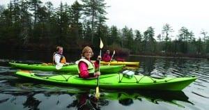 Three of the authors, Carol Moseman (left), Kathy DeLong (center), and Ruth Dandrea, paddle on Long Lake.