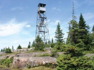 An abandoned fire tower still stands sentinel on St. Regis Mountain. Photo by Tom Woodman