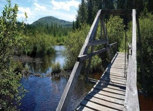 The Scarface Mountain trail crosses Ray Brook on a wooden bridge built by state prisoners. Photo by Susan Bibeau