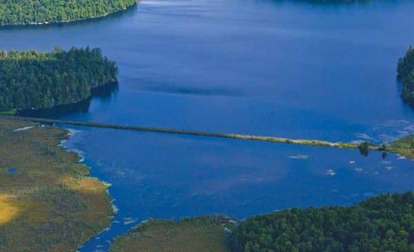 An Adirondack Scenic Railroad train travels between Saranac Lake and Lake Placid. By Nancie Battaglia