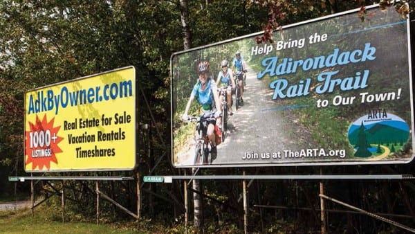 A billboard in Tupper Lake urges residents to support the trail option. Photo by Nancie Battaglia