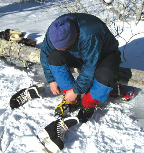 A log is an ideal bench for lacing skates.