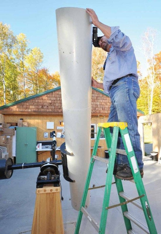 Marc Staves inspects a telescope outside the Adirondack Public Observatory in Tupper Lake. Photos by Pat Hendrick