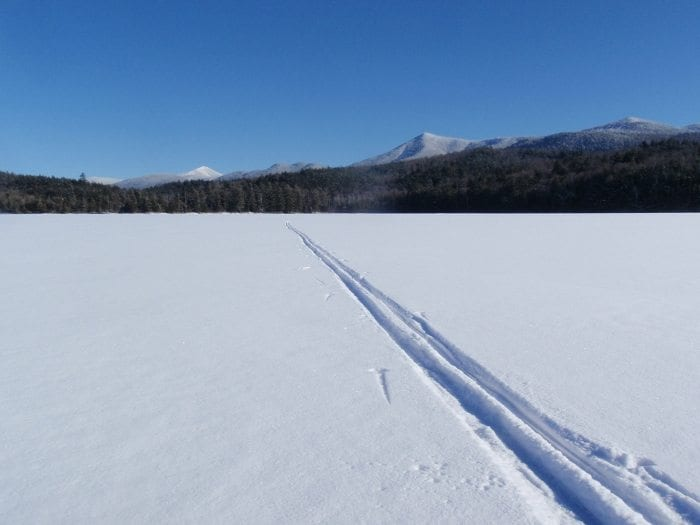 Whiteface Mountain (in distance) and Moose Mountain as seen from Moose Pond. Photo by Phil Brown.