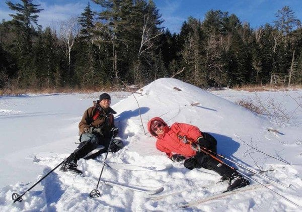 Ethan and Kim take a break at a beaver lodge. Photo by Phil Brown.