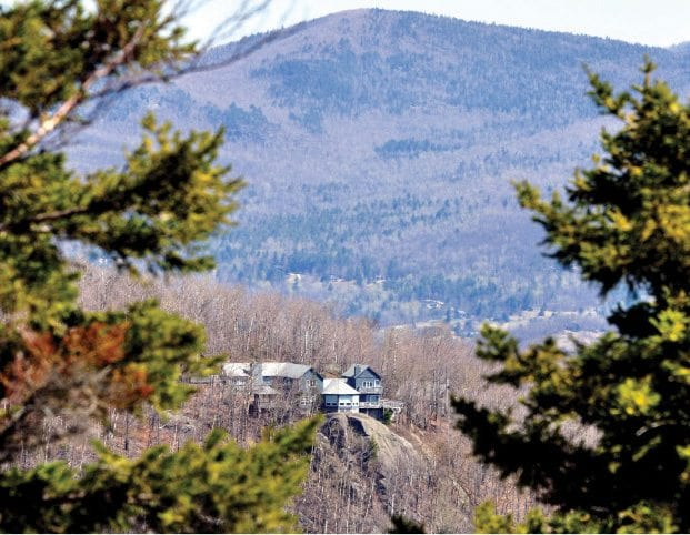 This home in Keene Valley is one of many that have cropped up on Adirondack ridges and hills in recent decades.   PHOTO BY NANCIE BATTAGLIA