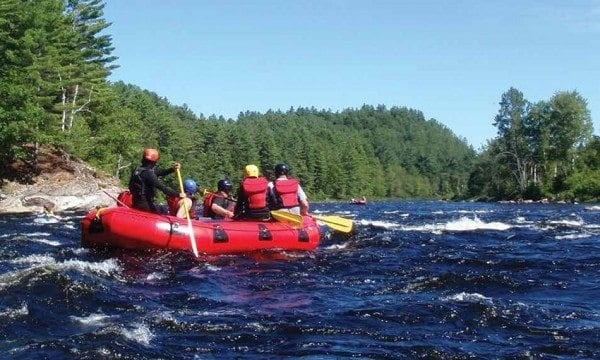 Rafters cruise through mild rapids toward the end of the seventeen-mile trip. Photo by Phil Brown.