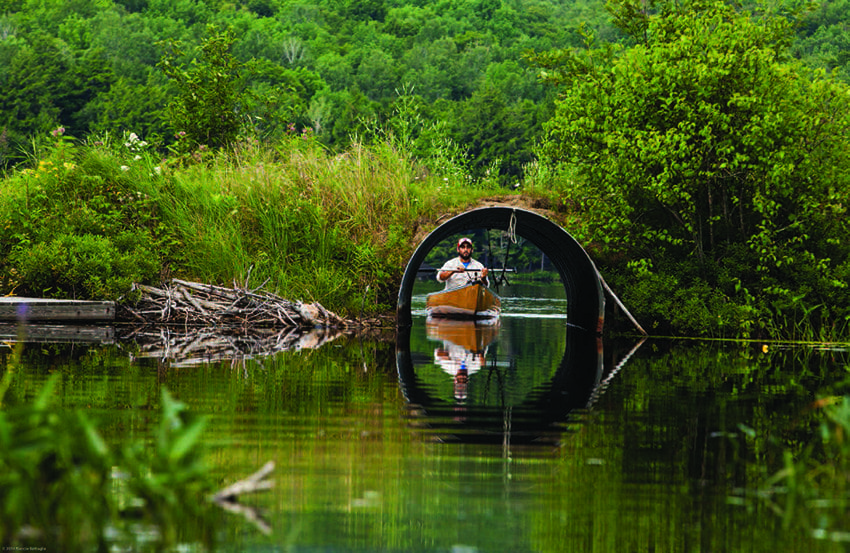 Paddlers must pass through a culvert when traveling between Fourth and Fifth lakes. Photo by Nancie Battaglia
