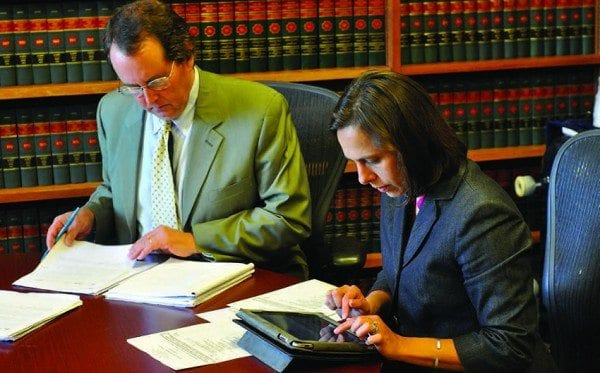 John Caffry and his associate, Claudia Braymer, prepare for oral arguments at the Appellate Division. Photo by Kenneth Aaron.