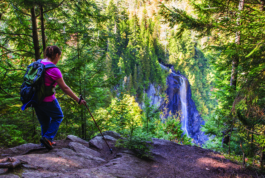 A hiker arrives at the lookout for OK Slip Falls. Photo by Nancie Battaglia
