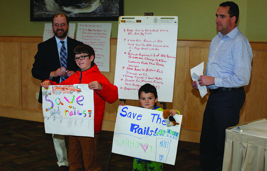 Brothers Galen (left) and Oliver Halasz of Saranac Lake show their support for saving the rails. Photo by Mike Lynch