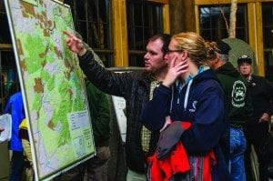 Matt McNamara and Meg Parker check out a map of the rail corridor at the Wild Center. Photo by Nancie Battaglia