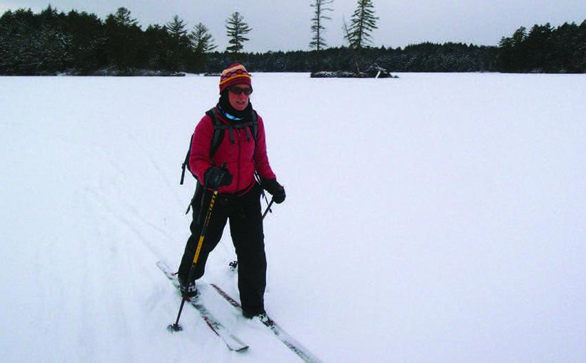 Carol MacKinnon Fox crosses Horseshoe Lake. Photo by Phil Brown