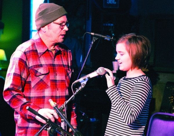 Scott Renderer helps Phoebe Amirault with a sound check at January Jams. Photo by Mike Lynch
