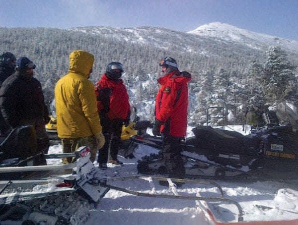 Rescue personnel confer at Marcy Plateau, about a mile below the summit of Mount Marcy. Photo courtesy of DEC