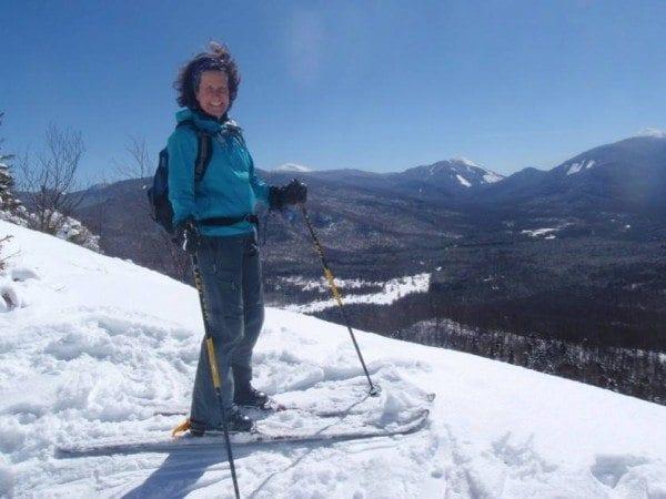 Carol MacKinnon Fox summits Mount Van Hoevenberg on skis. Photo by Phil Brown.