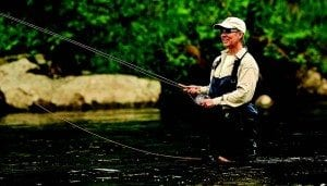 Gay Barton casts for trout in the West Branch of the Ausable. Photo by Nancie Battaglia