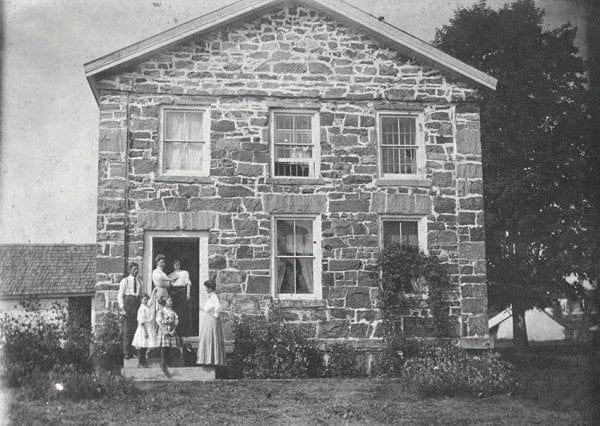 This old jail in Hamilton County housed the Windfall Gang in 1899. Shown are the jailer and his family circa 1900. Courtesy of Hamilton County Historian.