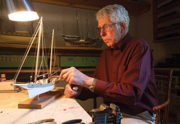 Bill Kissam crafts museum-quality models in his Westport home. Photo by Mike Lynch