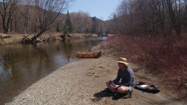Brian enjoys a repast of figs on a gravel bar two miles up the Opalescent. Photo by Phil Brown