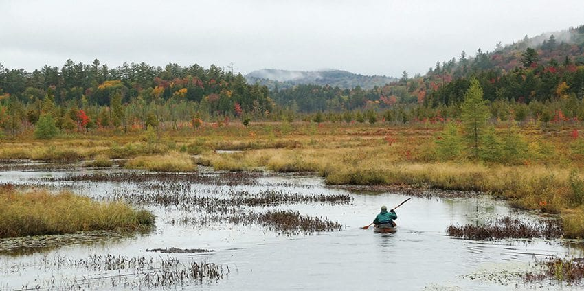 Will Madison paddles Brown's Tract Inlet in Raquette Lake on his way to Old Forge. Photo by Mike Lynch