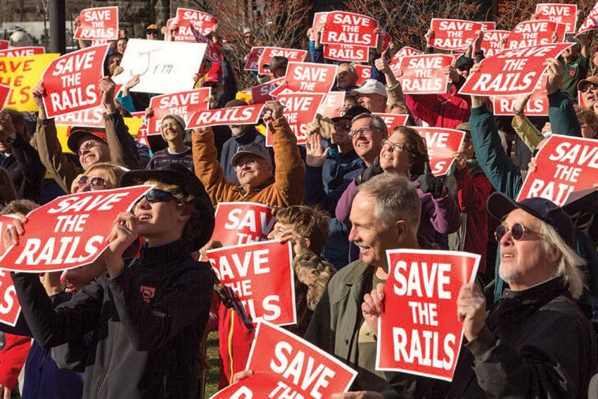 "Supporters of the railroad gathered at the Saranac Lake Union Depot in November 2015 for a ""Save the Rails"" rally. Photo by Mike Lynch"