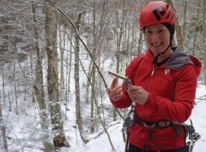 Sabrina holds an ice screw. Photo by Phil Brown