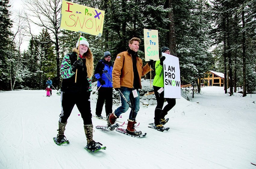 "Adirondack Youth Climate Summit students hold an ""I Am Pro Snow"" rally at Mount Van Hoevenberg in January. Photo by Mike Lynch"