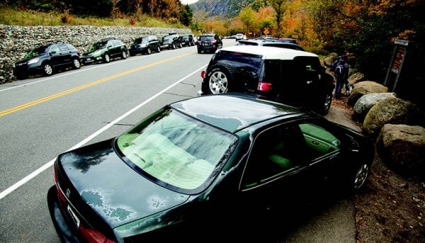 The high number of cars lining Route 73 at popular trailheads has raised safety concerns. PHOTO BY MIKE LYNCH